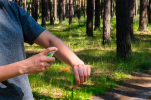 repel mosquitoes by using insect repellant